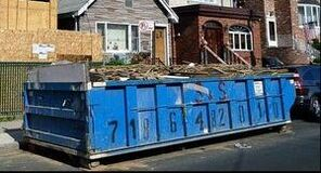 roll off dumpster in Albany NY filled with garbage